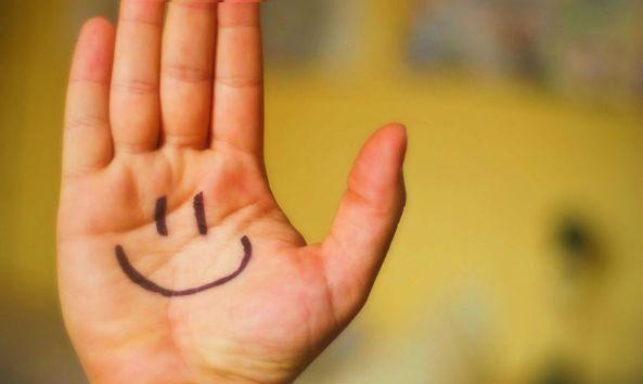 logo icono mano sonrisa felicidad